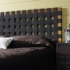 Woven seagrass headboard on simple frame. This would be easy to make with any rope-like material for far less than $500!