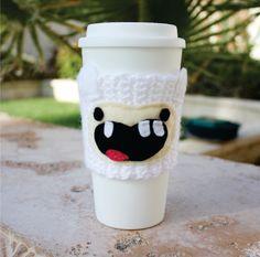 Finn The Human Boy Inspired Coffee Travel Cup Mug Cozy: Adventure Time -ish Eco - Friendly Crochet Knit Sleeve. $17.00, via Etsy.