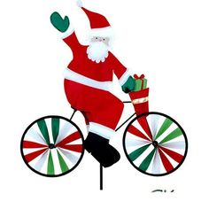 """20"""" Santa on a Bicycle Garden Spinner by Premier Kites & Designs. $31.49. Measures 20 inches by 20.5 inches and 7 inches in diameter.. Measures 20 inches by 20.5 inches and 7 inches in diameter."""