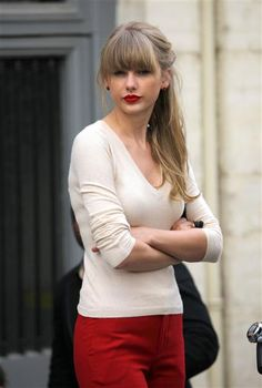 Bangs are all the rage this fall! And we love Taylor Swift's blunt cut bangs and high ponytail. See more celebs on Wonderwall. http://on-msn.com/OBVgOO