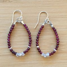 """Polished garnet beads and Herkimer diamonds make a stunning statement in these beaded hoop earrings. Karen Hill Tribe silver beads sparkle amid the gemstones. These earrings are 1.75"""" in length and hang from sterling silver ear wires. The garnets are 2mm. Garnets are January's"""