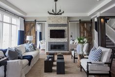Rochelle Cote Interior Design. Hospital Home Lottery Showhome. August 2014. Backing onto the Lake in Mahogany we wanted to make sure this show home was created to have a cottage feel. We used rustic wood floors & reclaimed wood to help achieve that. The sofa white & grey backdrop & navy accents read very nautical.