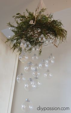 DIY Clear Ornament Hanging Chandelier - This was a pain in the ass to make, but it looks pretty cool when finished.