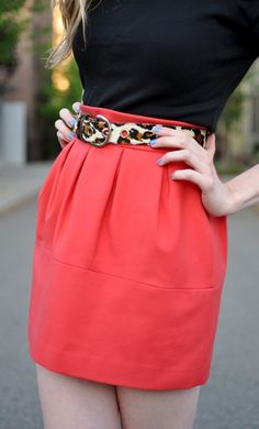 Coral skirt, black shirt and leopard print belt