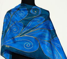 Navy and blue silk scarf handpainted. Gold swirls art deco leaves. Hand painted Pure silk scarf in royal blue and dark navy blue colors . The leaves open like feathers and are decorated with gold swirls . I painted this lovely piece on pongé shiny silk with a lot of care in Sardinia Island ,