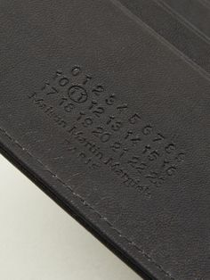 Debossed text in leather.