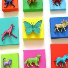 Cover small figurines in glitter and mount to painted canvases for some stunning wall art!
