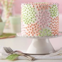 Celebrate a brand-new spring season with this buttercream-iced cake decorated with colorful flowers piped using the bead technique. Learn how to do this simple technique and more by taking The Wilton Method of Cake Decorating Course 1.