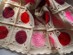 Granny square blanket in cream with red and pink circles, modern crochet afghan