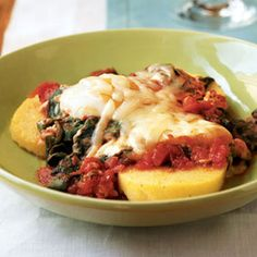Italian eggs over spinach and polenta. Start your day with veggies, protein, whole grains, and deliciousness. What more could you want? Oh,yeah it is really easy and fast and cheap to make too. I replaced the asiago with low-fat mozzarella and it was fantastic.