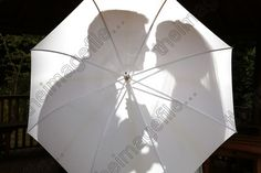 shillouette though white umbrella | chris normandale photographer chris normandale collection people photo ...