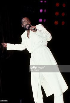HALL Photo of Marvin GAYE, Marvin Gaye performing on stage, wearing robe
