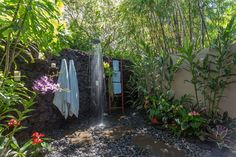 Exterior. Fresh-air Outdoor Showers Design Like Bathing In Paradise. Outdoor Showers Decor Ideas Features Cultured Stone Wall And White Double Towel And Chrome Rounded Shower Head Along With Ladder Towel Racks As Well As Natural Stone Stepping And Massive River Stone And Also Small Tropical Gardening. Fresh-air Outdoor Showers Design Like Bathing In Paradise