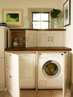 Instead of using bifold doors to block off the laundry room, turn it into usable space by adding wide cabinet doors and putting a finished countertop