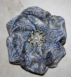 Sewing Fabric Flowers When Candace Kling came this year, she taught us a new fabric flower called the Margaret Phillips Rose. I am so in love with doing this fl. Mens Ties Crafts, Tie Crafts, Sewing Crafts, Sewing Projects, Sewing Ideas, Necktie Quilt, Diy Fleur, Old Ties, Kanzashi