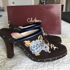 Stunning suede leather dark chocolate Kyrene clog Just gorgeous suede clog with blue velvet lining and beautiful embroidered flower pattern. Worn once and in excellent condition.NO flaws just bottom wear. Perfect. Come in original box and were impeccably stored. Will consider all reasonable offers. Cole Haan Shoes Mules & Clogs