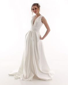 Take the plunge with our absolutely stunning satin wedding dress with pockets…