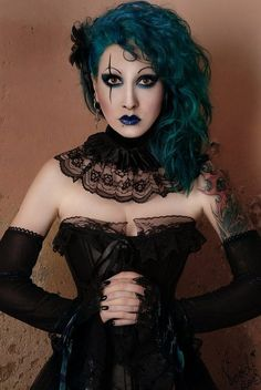 Makeup, lace collar and HAIR! I want my hair to be that color.