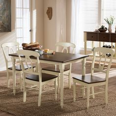 This attractive dining set features antiqued cherry top and creamy buttermilk paint finished base for a casual, vintage-inspired look.