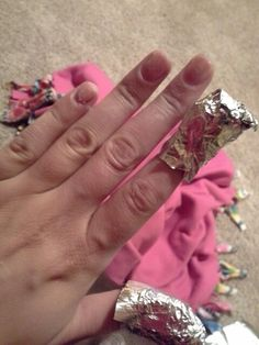 Best way to take off acrylics! I have tried every other way from sawing with dental floss to picking and ripping them off. Use acetone nail polish and get a cotton ball wet, place it on your nail. Wrap tin foil (I used highlighting foil from the supply house) around the nail and let it sit for about 10-15 minutes. When you take the foil off your nails will be jelly like. Use the rounded side of a metal cuticle pusher and scrape off the excess nail remaining. And boom, your nails are off.