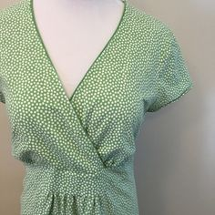 """Boden Dress Easy casual chic with this light green and white polka dot dress. Some small gathering in the front at waist. Crossover front bodice. 36"""" at waist, 40"""" at bust, and about 43"""" from shoulder to bottom hem. Medium weight stretch knit fabric. Listed as a 14Long. Boden Dresses Midi"""