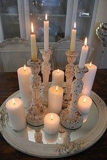 candle sticks on mirror