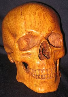 Hand carved wooden skull by Artisemadra.