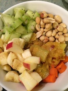 Vegetarian curry with peanuts, apple, and cucumber and shallot salad.