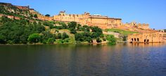 Amer Fort Jaipur  Amer Fort was constructed by Raja Man Singh. Amer Fort is recognized for its creative style of Hindu essentials. With its huge fortifications, chain of gateways & paved paths, the fort overlooks the Maota Lake.   http://www.tourpackagesrajasthan.org/amber-fort