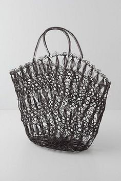 This is a must have in seattle! I hate that you cant get grocery bags anymore...but this bag is a cute replacement :)