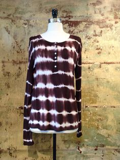 This brown tye-dye number is a perfect casual staple for fall, with long sleeves to keep you warm and a button down scoop neck this shirt is great for everyday wear.