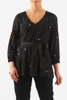 Delight in night sky prints with our statement sleeve georgette top cut in a flirty peplum silhouette and cinched in with a removable sash tie belt.