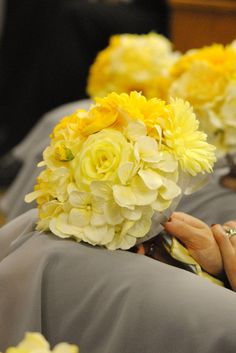 not a huge fan of the yellow, but i love the style and monochromatic-ness of this bouquet. annnnd it has a lot of the flowers i love (gerbers, hydrangea, rununculous...just needs peonies)