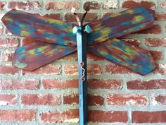 Table Leg Dragonfly DIY creation using re-purposed ceiling fan blades as wings. I call this one Argentine Night Flight. Check out my website for all my dragonfly creations.  This one is for sale at the La. Gift Basket Company in St. Francisville, LA