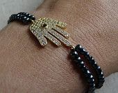 Gold Hamsa Hand Charm with navy beads bracelet £22.50