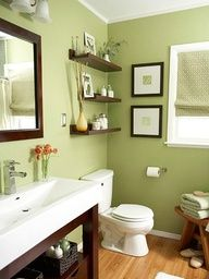 Guest bathroom ideas.....Whats not to love about sage green, wood, and a touch of orange....I would add more orange to this color scheme...