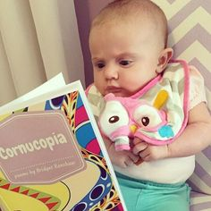 It looks like we have a future Cornucopia reader on our hands. Little Emma definitely looks intrigued. Thanks for the picture Ashley!  If you have a photo of the Cornucopia book send it our way! Tag @cornucopiapoems and we will repost and give you a shoutout. Much love!  #futurereader #childrensbook #childrenspoems #childrenspoetry #scholasticbookfair #teacherlife #momlife #lundeens #vromans #pengiunbooks #momsofinstagram #teachers #littlereader #cutebaby #babies #fanphoto