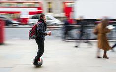 Simon Mansfield, 25, from Richmond, riding an AirWheel self-balancing unicycle through London