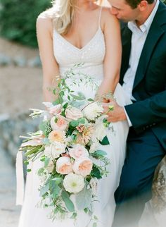Dahlia, garden rose and rose cascading wedding bouquet: http://www.stylemepretty.com/south-carolina-weddings/greenville-south-carolina/2017/03/10/this-is-how-a-wedding-stylist-says-i-do-at-home/ Photography: Rach Loves Troy - http://rachlovestroy.com/