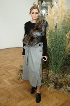 Ever the mix master, Olivia showed her styling prowess, adding a furry finish to a wrap skirt and crew-neck...