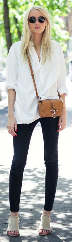 Ellen Claesson is looking stunning in black skinnies, a white shirt and open-toed heels! Shirt: H&M, Jeans: Gina Tricot, Bag: Givenchy, Shoes: Nelly