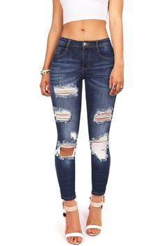 "Ankle length mid-rise jeans with ripping and distressing down the front. Zip fly and button closure. Little stretch in denim, runs slightly smaller. *Machine Wash Cold *97% Cotton 3% Spandex *37""/94cm"