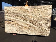 NEW! Betularie Granite from Brazil has browns taupes and creams with darker veins.
