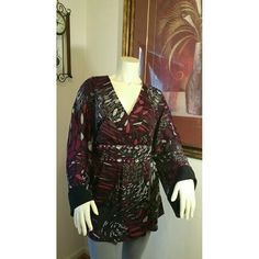 New Plus Size 3X Jeweled Tunic Kaelyn Max soft Knit multicolored tunic/ top comes in Woman's Plus Size 3x. This lovely top has a V-neck line, bell sleaves and ties in the back for a great look. Wear with leggings, skirts or jeans. This is a loose sweater knit material, has some stretch and it is machine washable. New with tags. 96% Polyester and 4% Spandex. (*NOTE: This is a size 3X top but it is pulled to the back in order to fit on the mannequin display) Kaelyn Max Tops Tunics