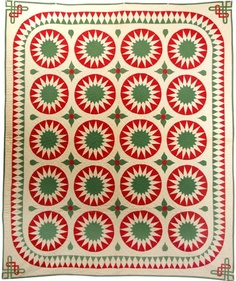 Sunburst Variation quilt in red and green with Celtic knot corners, posted by Lisa at Stray Threads:  The 12th Day of Christmas