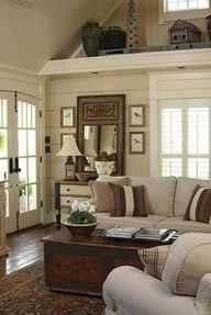 Love this cottage style sitting room  (shelf above windows)