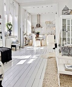 All white open plan interior