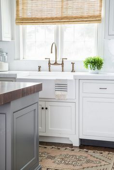 Chelsea gray island white dove cabinets both BM Renovated Home with Coastal Interiors