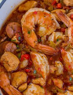 Easy Jambalaya made with Chicken, Shrimp and Andouille Sausage in under 45 minutes. Served over rice or rice cooked with the jambalaya for one pot meal. Creole Recipes, Cajun Recipes, Seafood Recipes, Cooking Recipes, Donut Recipes, Calamari Recipes, Chicken And Shrimp Recipes, Pork Recipes, Cooking Ideas