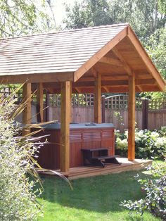 wish....The hot tub is open at the sides but has a roof above for protection from the weather.
